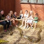 Group of children with snake