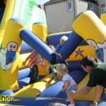 children on small bouncy castle